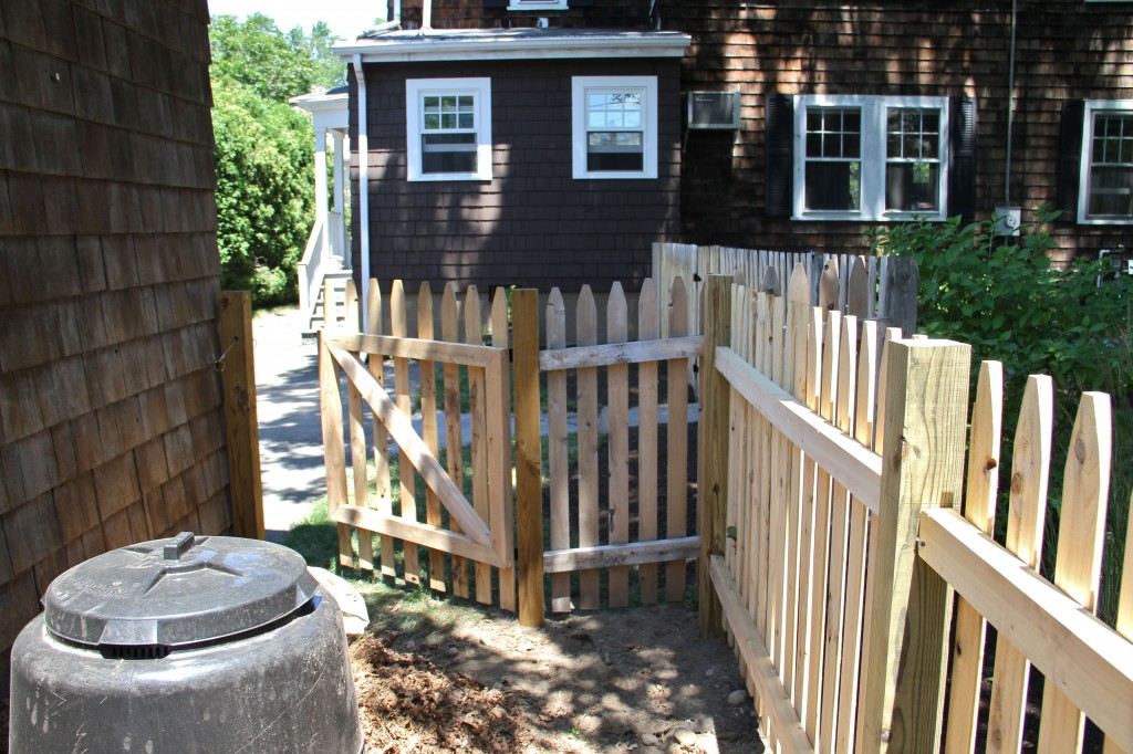 DURING: After we had the fencing installed we had to stain the fence and decide how to deal with the ground surface.
