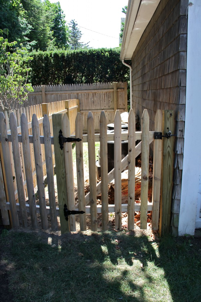 DURING: The gated area is right off the driveway, so grass clippings, food scraps from the kitchen, or bit from the rose bushes and (budding) herb garden can easily head straight for the compost.
