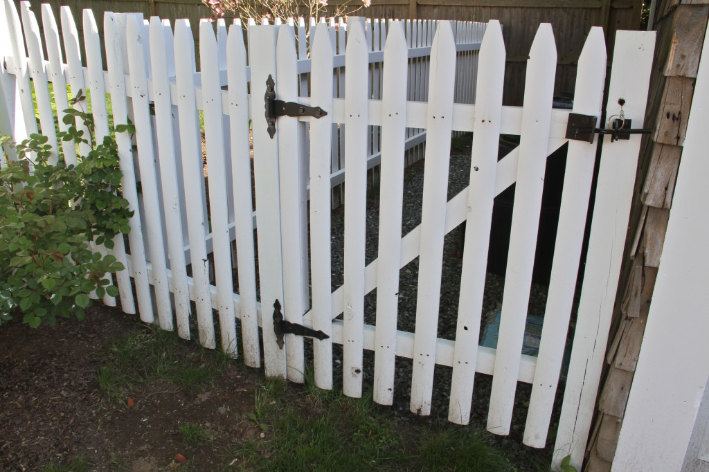 AFTER: Plain white on the fencing gives a crisp tie-in to the white trim throughout the entire house. Plus, if you have a picket fence, and you live in New England, why not make it a classic 'white picket fence'?