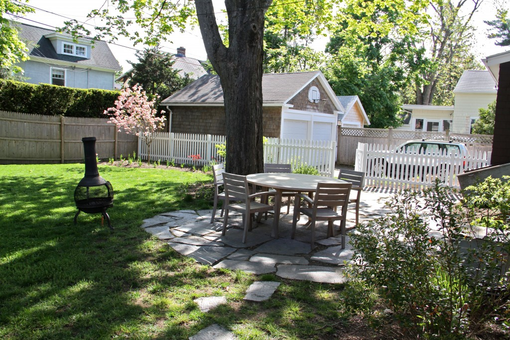 AFTER: The yard is getting there, and so are the trees. Soon it'll be time for BBQ's, fizzy bubbly drinks in the summer air, and warm breezes that lift your spirits and carry your troubles away. Ahhhh.