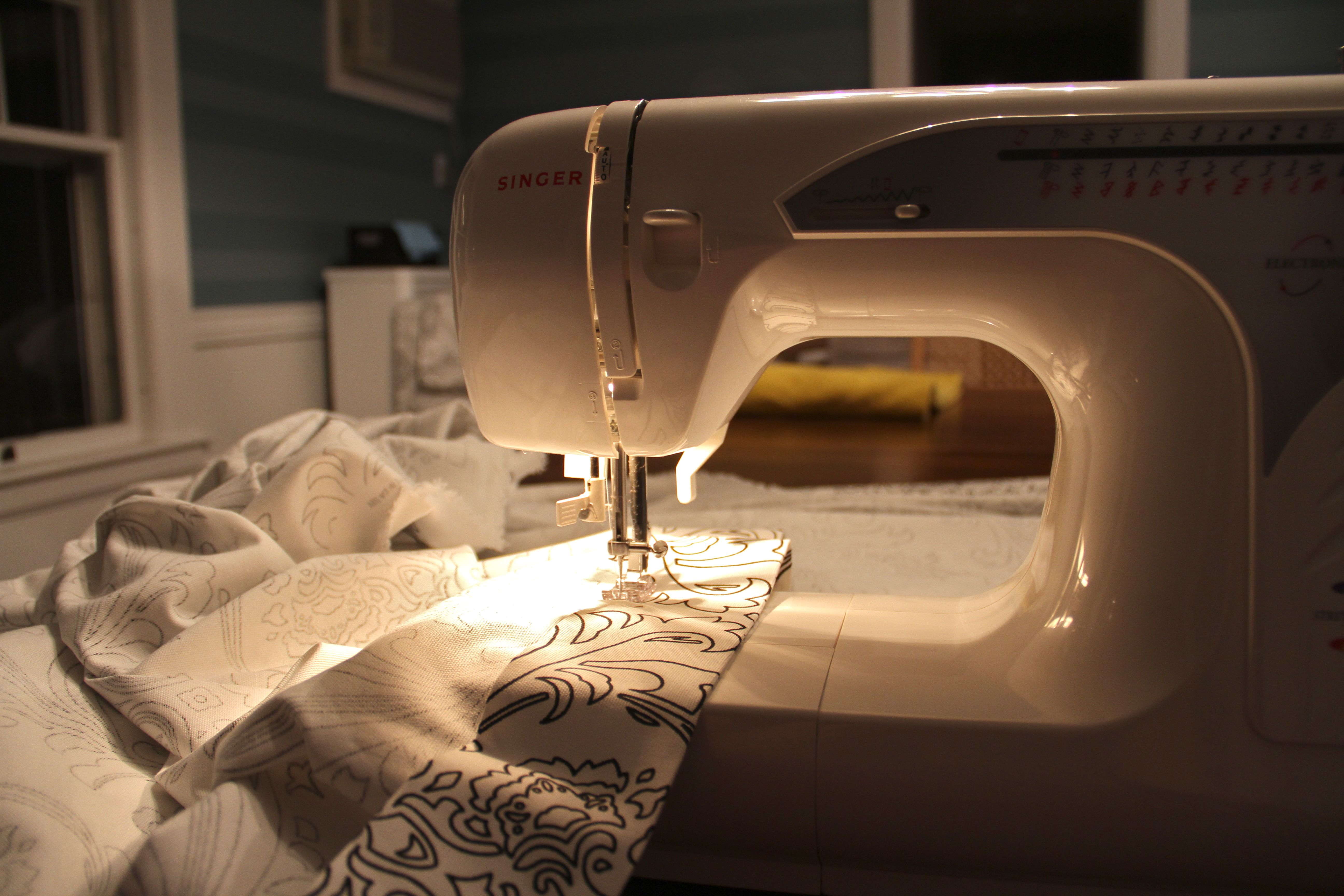 Once the sides were ironed, pinned, and ironed again, I was ready to sew.