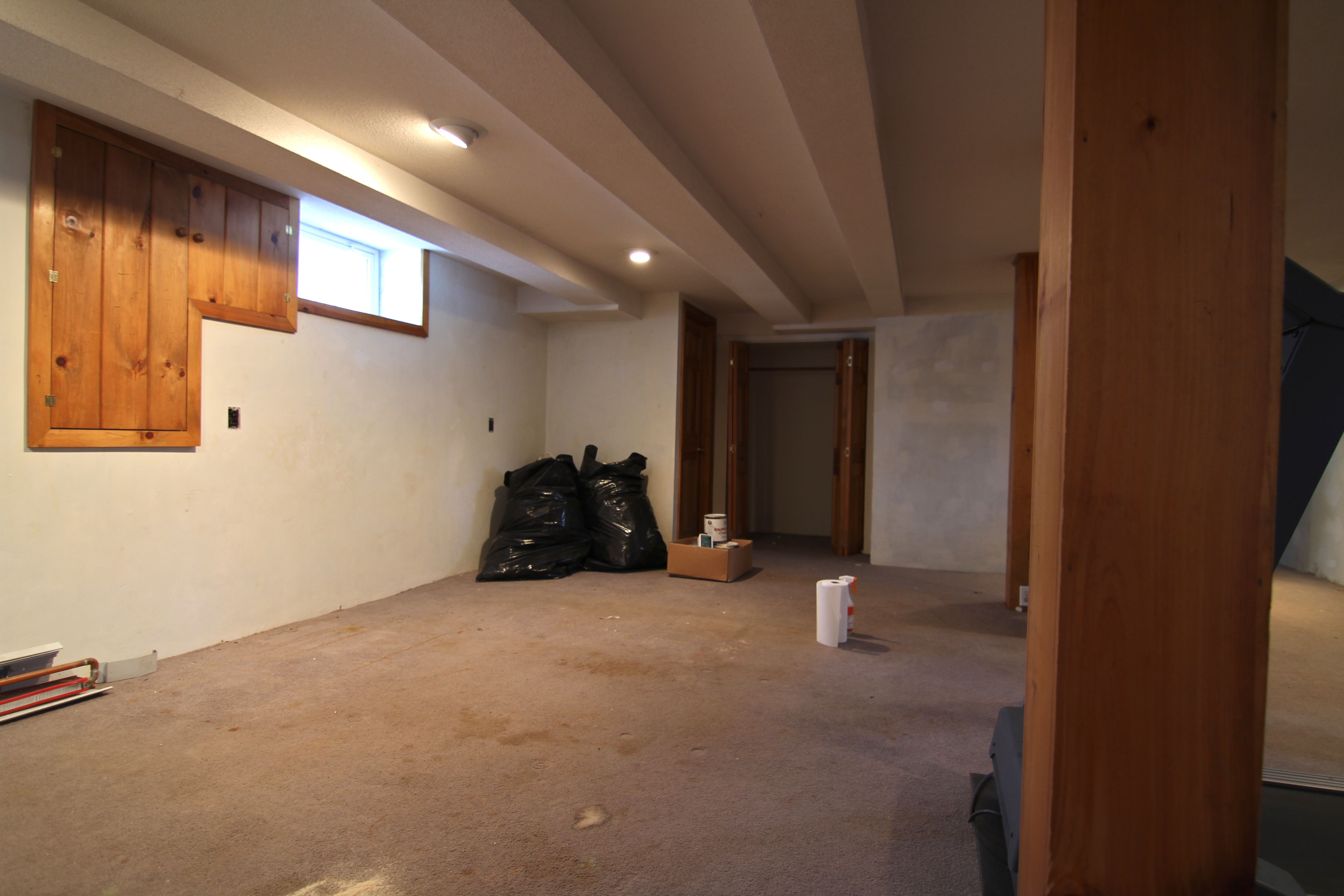 BEFORE: When we bought the house there was a crusty-old sofa that was rusting away in this area of the room. The stains throughout the space were equally non-mysterious and gross - clearly the carpet was years beyond a simple cleaning as a remedy.