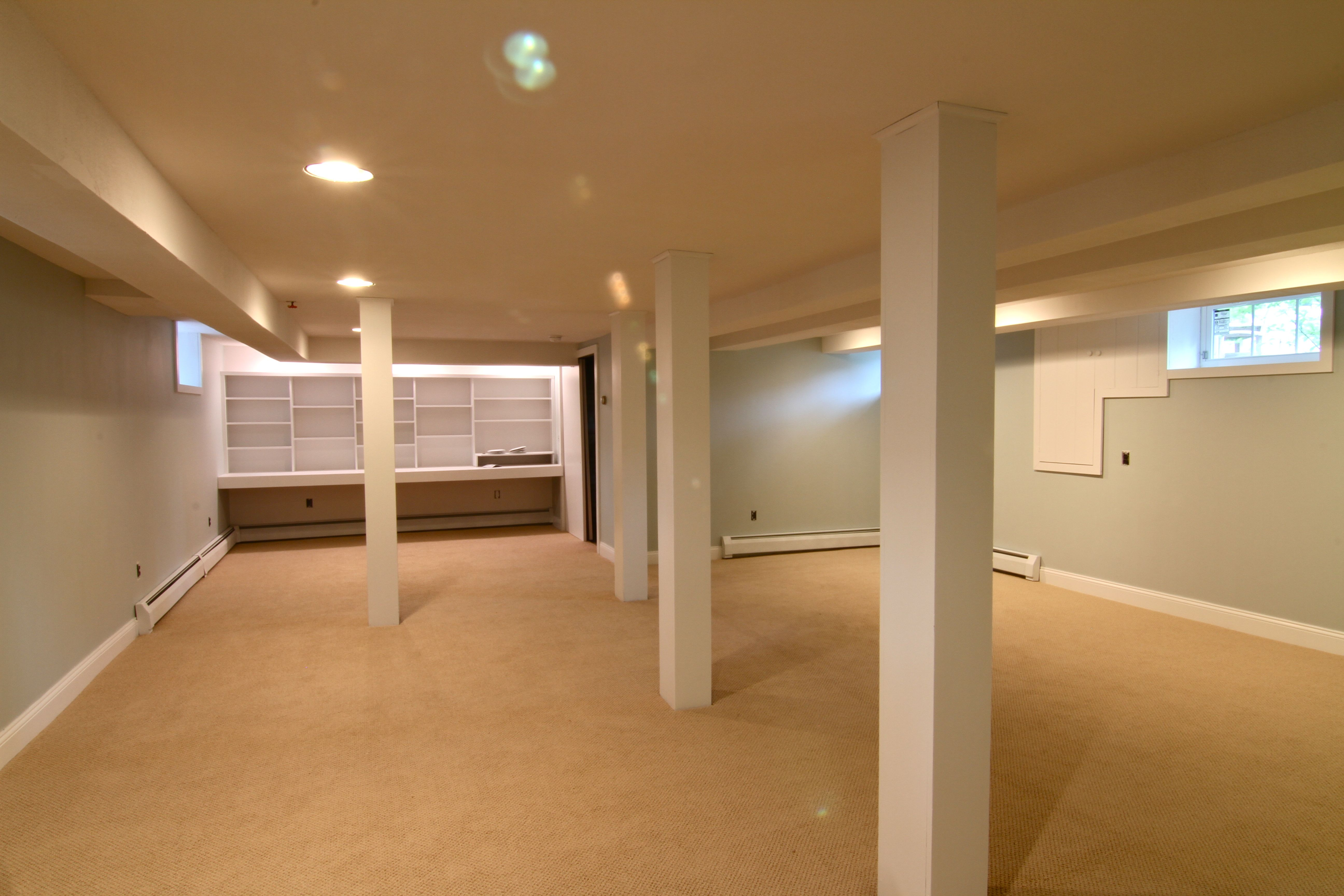 Basement AFTER: new paint, new carpet, new baseboards make for a bright, fresh, inviting any-purpose space.