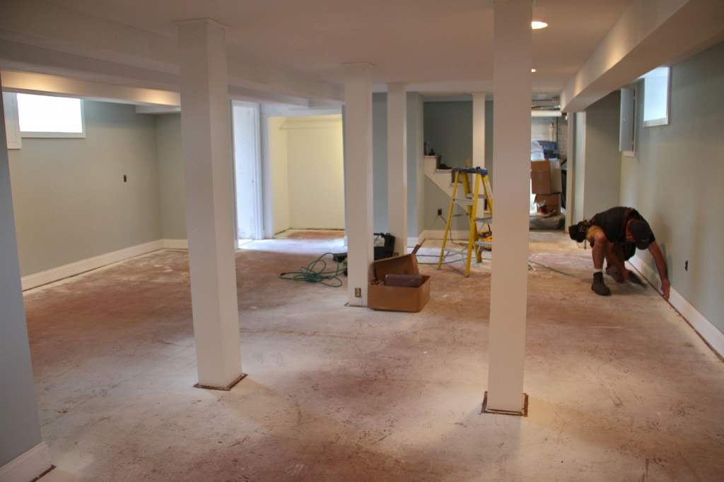 DURING: Jonas working the nail gun, installing 60' of baseboard trim in a matter of a few short hours.