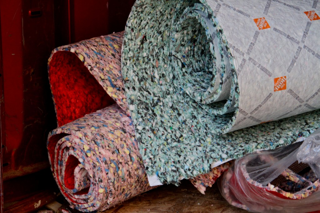 Rug pad! We chose to use a low VOC recycled option from HD because it was the thickest, and fit into our budget.