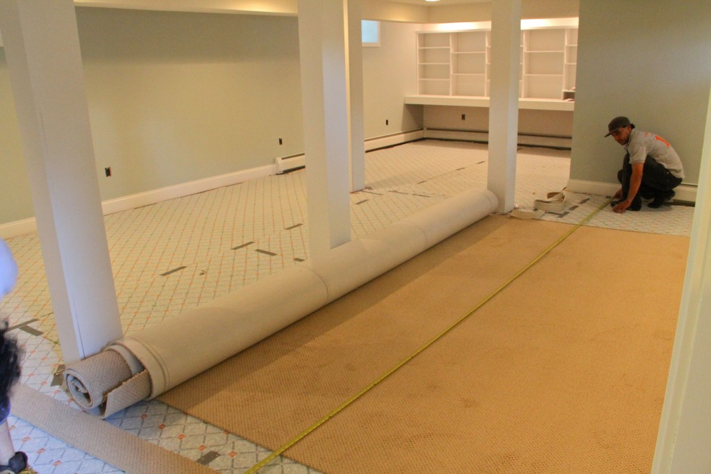 DURING: The carpet was measured and cut in the space, but the plan for where the seams would go, and how many rolls of carpet we'd need was determined when we placed our order.