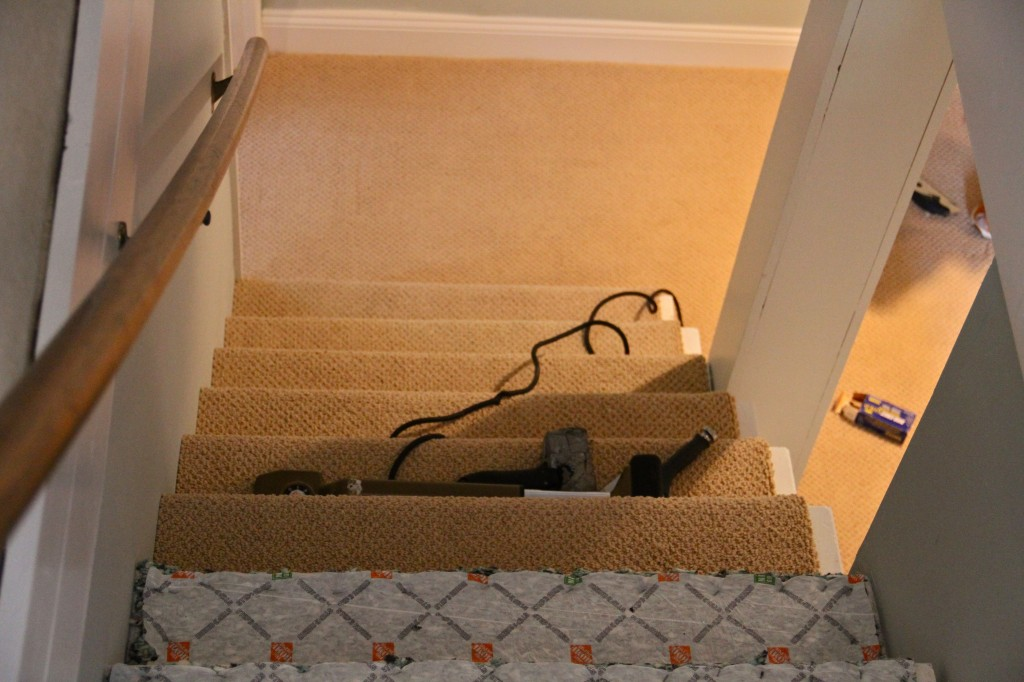 DURING: We ended up having the carpet tucked underneath itself on the stairs where the sides were exposed to the room. It made for a good compromise: no 80s stair wrap, and a bit of exposed white to add to the crisp freshness of the trim throughout the space.