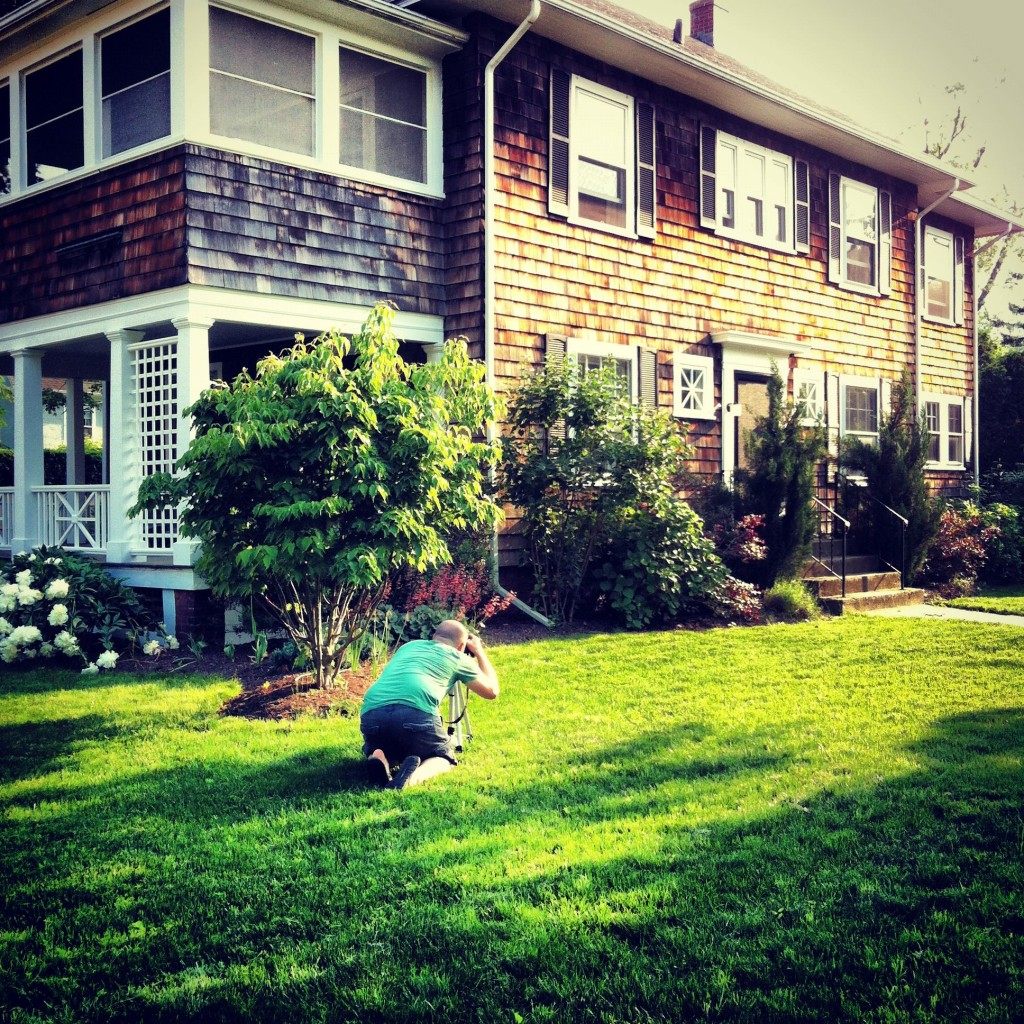 My favorite little photographer working on some spring shots of the house.