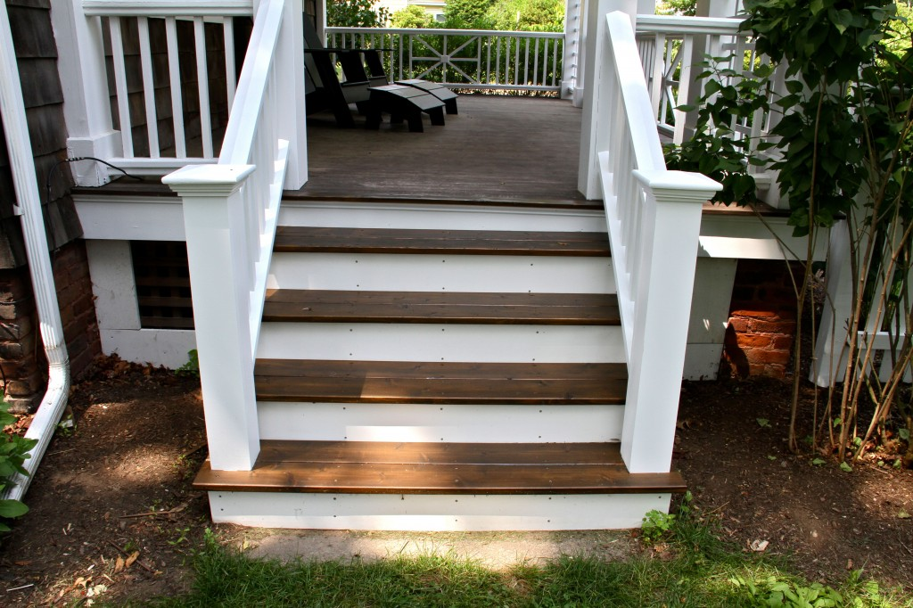 AFTER: The porch stairs, railings painted to match the rest of the trim and porch railings; treads re-stained with Cabot exterior oil-based stain in Burnt Hickory.