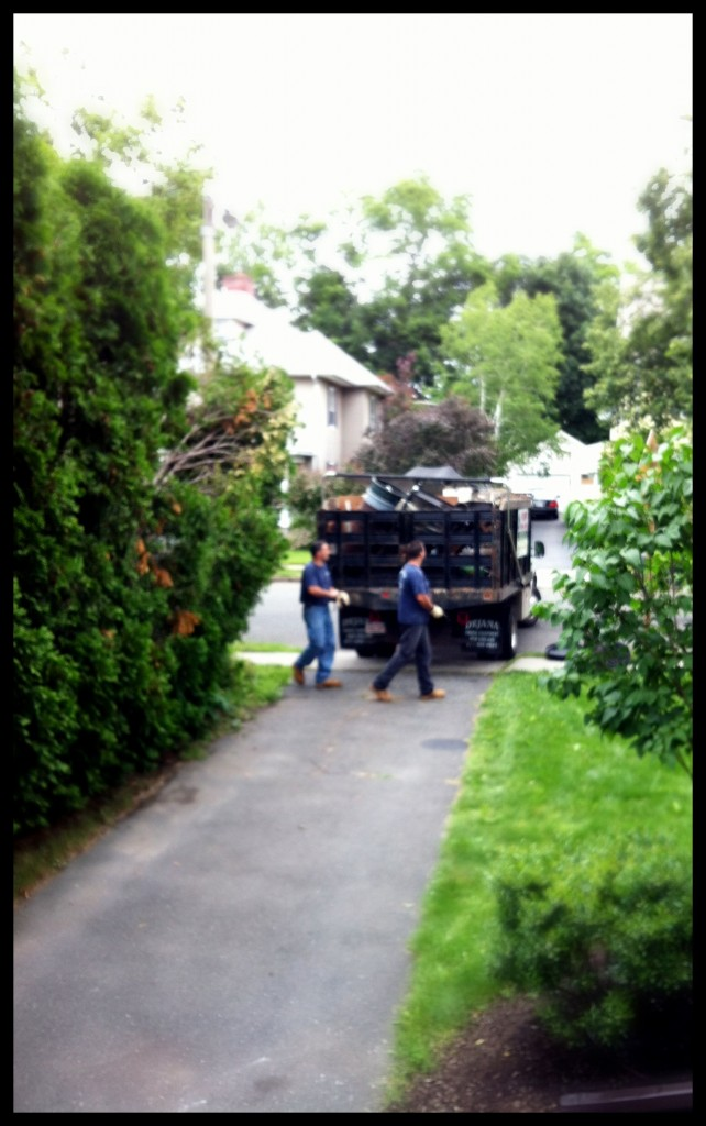 The guys of Prompt Removal Service promptly removing their truck from our too narrow driveway.