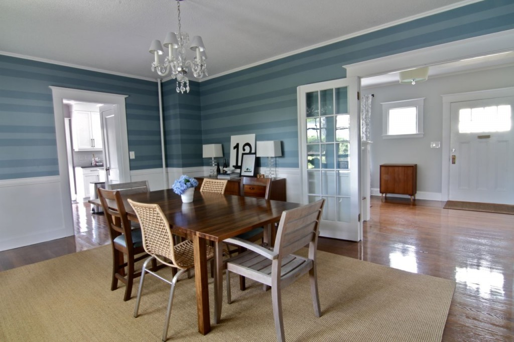Dining room looks onto foyer, kitchen and living room for open-concept living 1920s-style.