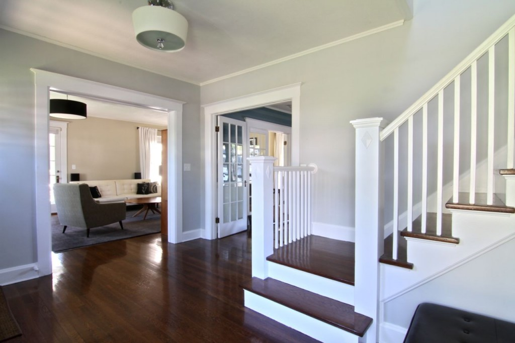 Facing back toward the living room, dining room and side porch.