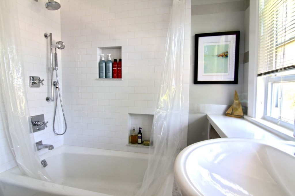 Family bath shower features niches for storage, a body spray hose, and new faucets/fixtures.