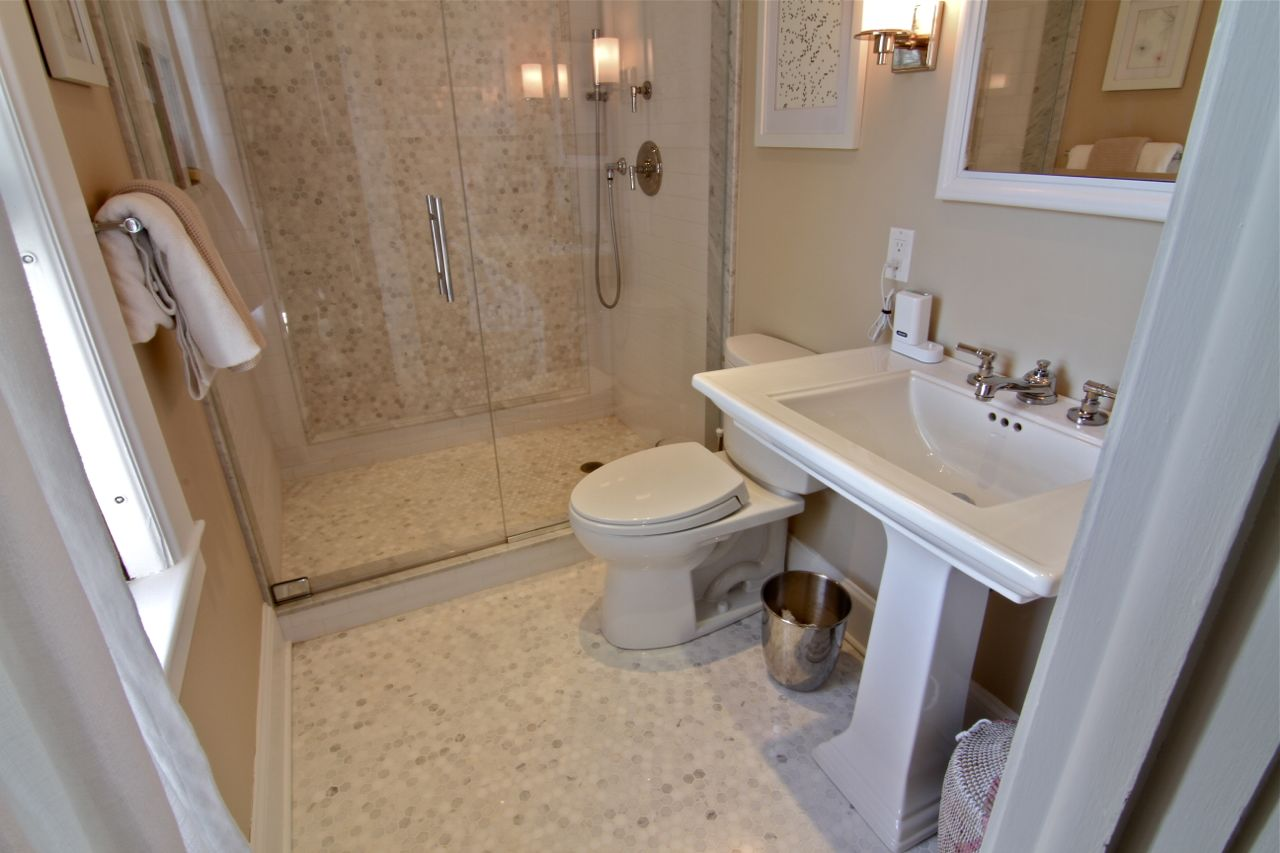 Master bathroom features marble floors with electric radiant heat, recessed medicine cabinet with custom frame molding, all new plumbing, and a Starphire glass shower door.