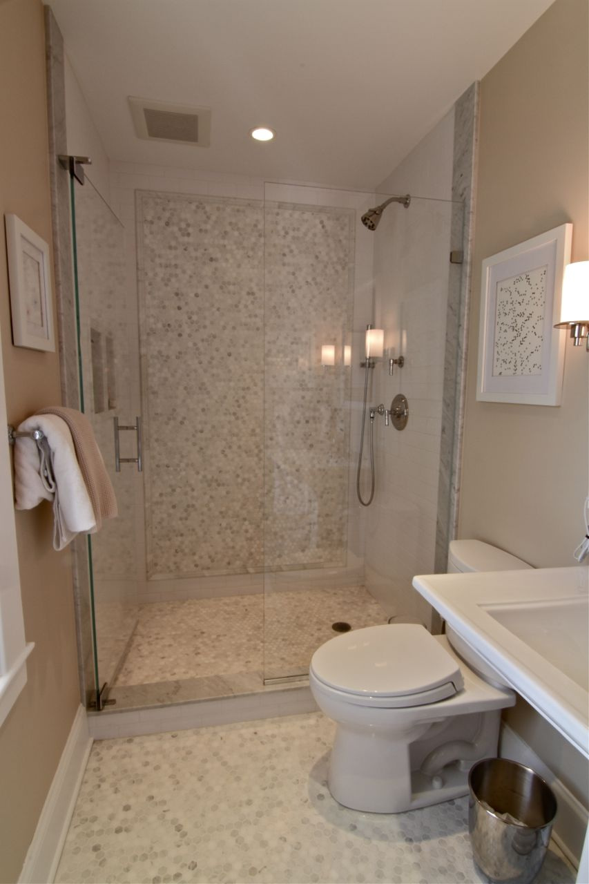 Formerly the maid's bathroom, the room now features modern amenities such as recessed lighting, dimmer switches and a whisper-quiet fan for ventilation.