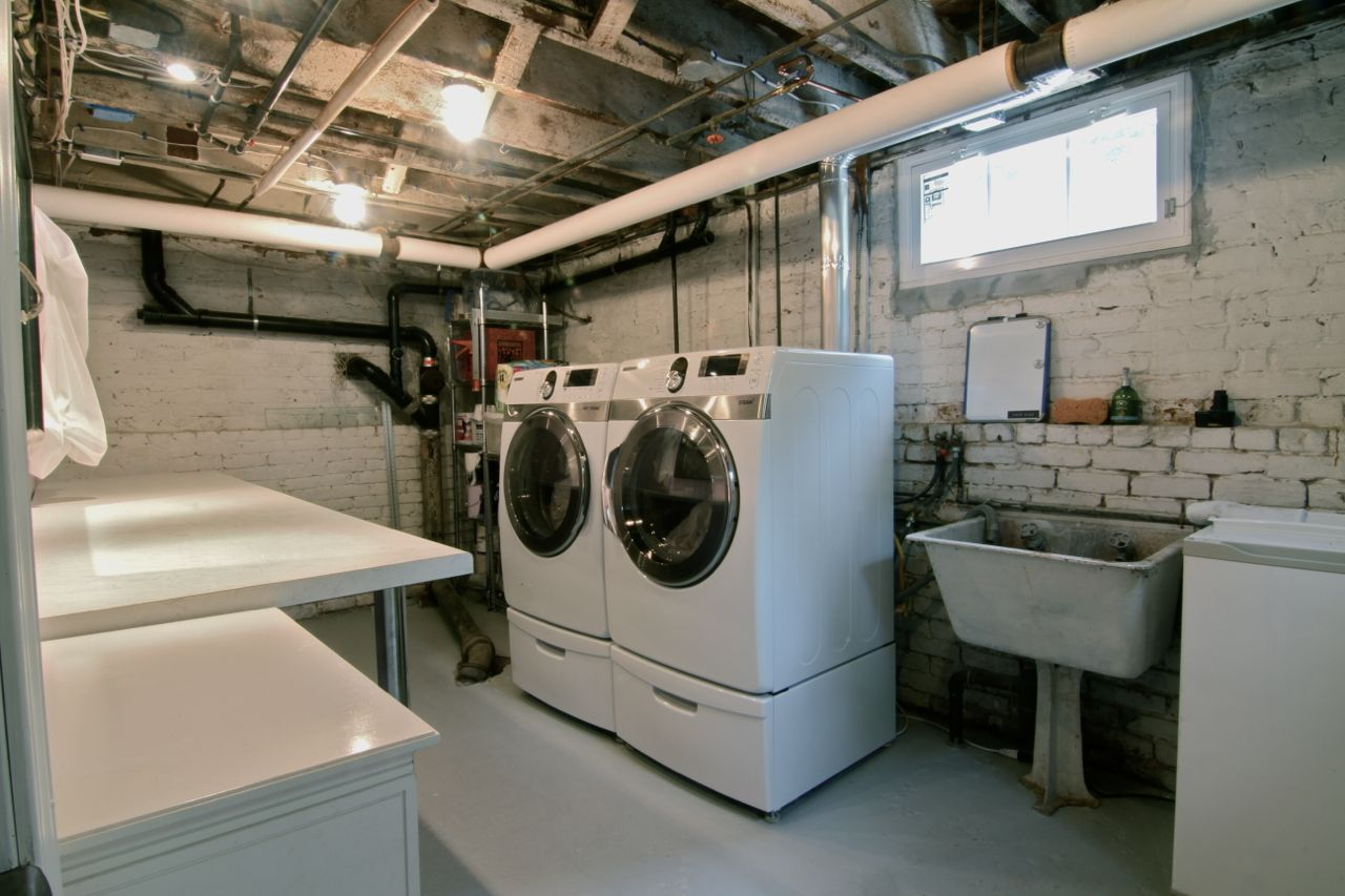 Laundry room. New washer and gas dryer installed in 2009. Folding area, freshly painted floors and new lighting.
