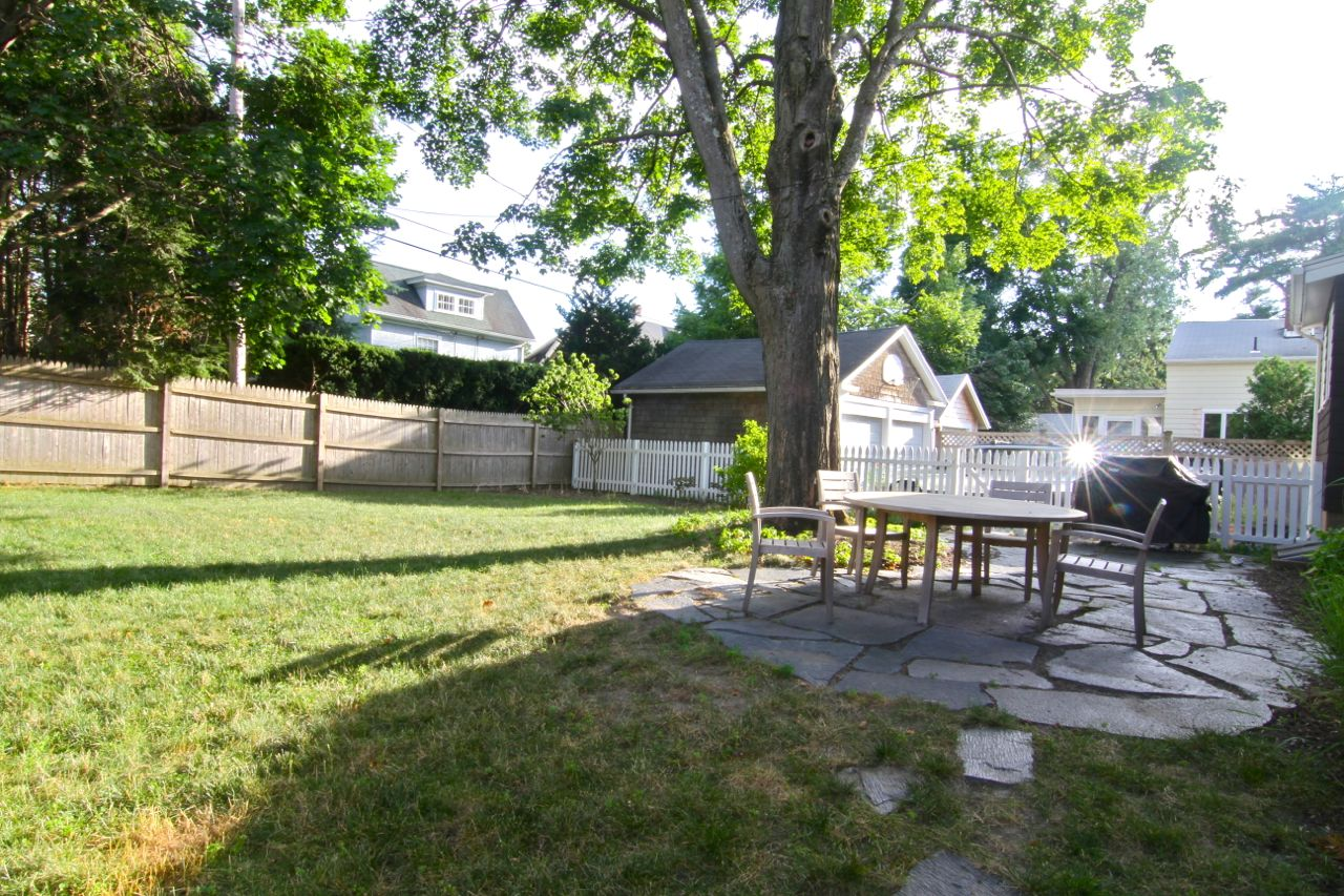 Back yard, redone in 2008, complete with sprinkler/irrigation system, Ashfield stone patio, fresh plants and freshly stained fencing.