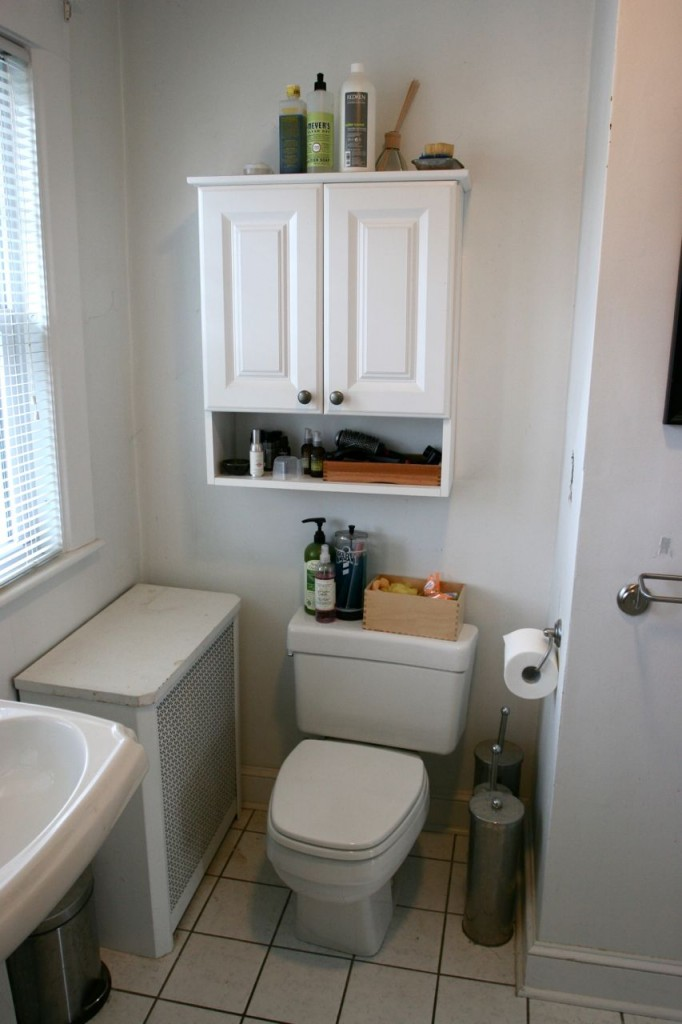 BEFORE: The aging toilet, the pitiful cabinet, the sad little radiator cover all had to go. Clearly, it wasn't working.