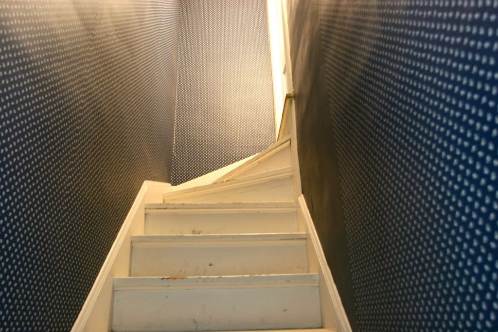BEFORE: This passageway, the maid's stair, was turned into storage on both levels - in the kitchen it became our tea 'n toast station, and upstairs a floor was added to create a roomy closet.