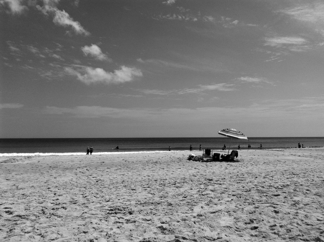 Before the beach completely filled up, and as people were setting up their gear, I snapped a few pictures that felt like another time.