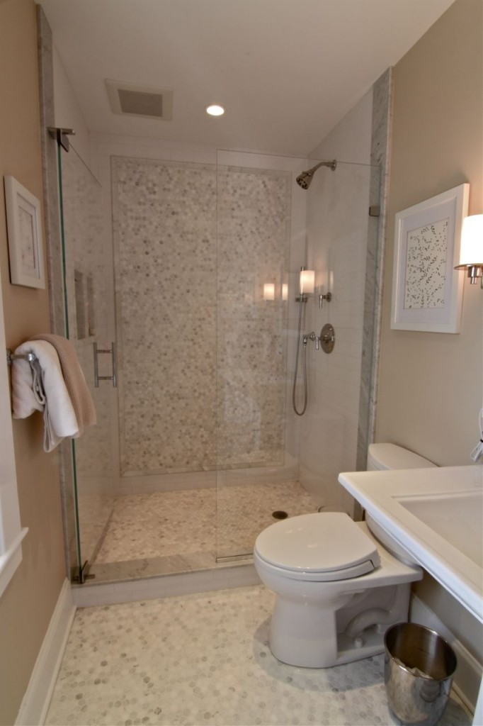 AFTER: Master bath, with custom shower, marble hexagon tile, heated floors and brand new everything.