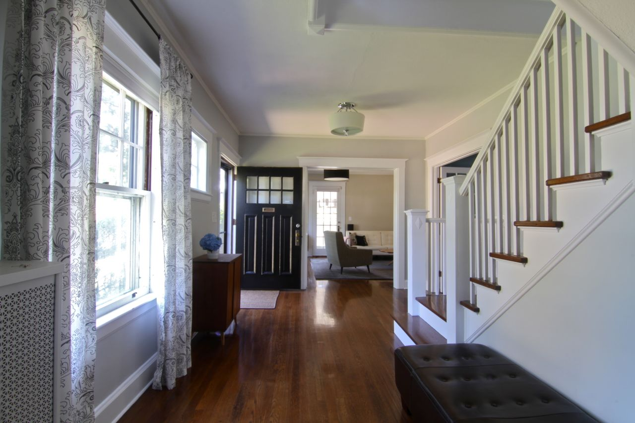 The foyer, or entryway, is both grand and homey. It connects virtually every space in the house, especially when you take into account that the two-story entrance snakes continues on through the hall that connects all the bedrooms upstairs.