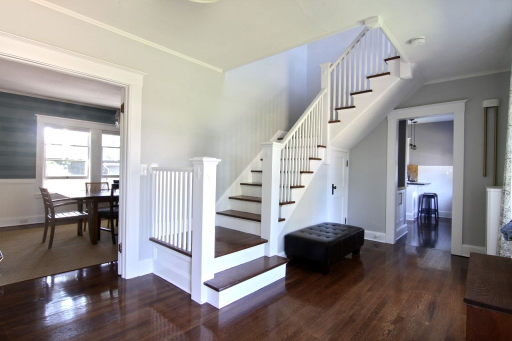 I love the way the staircase is both inviting, and signals a change in the purpose of the home. I believe it is evident that the public space ends at the staircase, but perhaps that's the old New Englander in me.