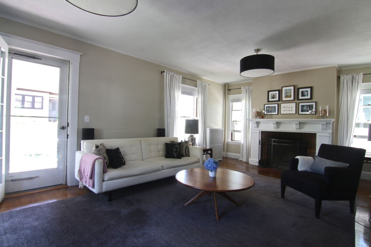 The generously sized living room (about 25' long) easily hosts our 8' long sofa, a few larger chairs, a table, as well as the fireplace and all its accoutrements.
