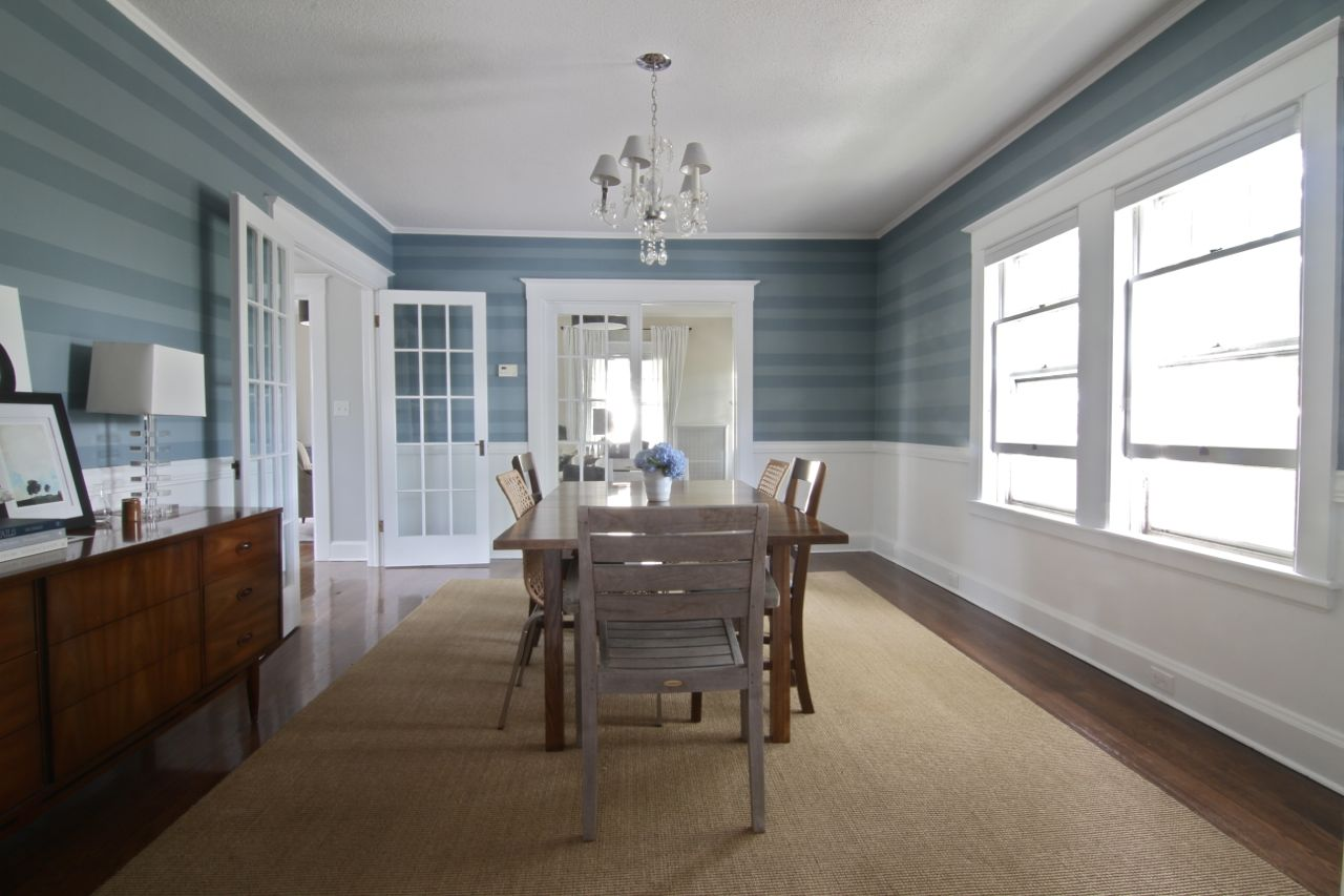 This dining room went through several paint colors before we arrived at this custom treatment. It's not wallpaper, just paint, painstakingly measured, taped off, and applied. Labor of love, and one of the earliest tone-setting design elements we arrived at. Still love it.