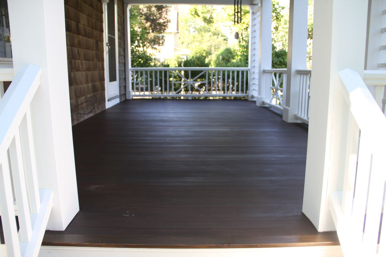 AFTER: With a new coat of rich brown the porch floor again resembles the rich, dark pine mulch we use that looks like fertile soil. I love the natural way it blends with the landscape, while providing a grounded and expansive visual plane.