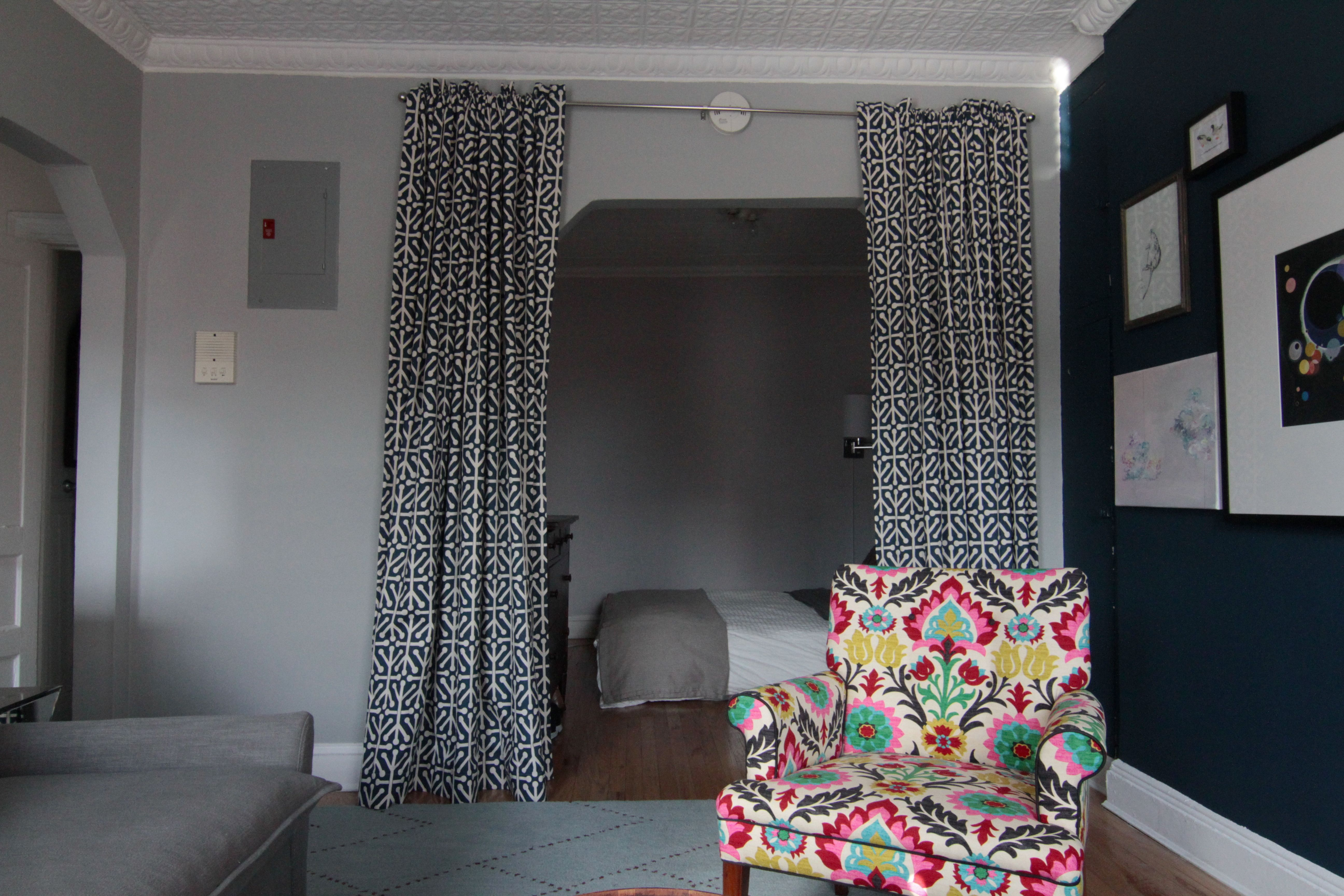 I made those curtains to create some doors/privacy after my sister had to stay with us for a few months. I was lucky that the color of the fabric matched so closely to the wall color.
