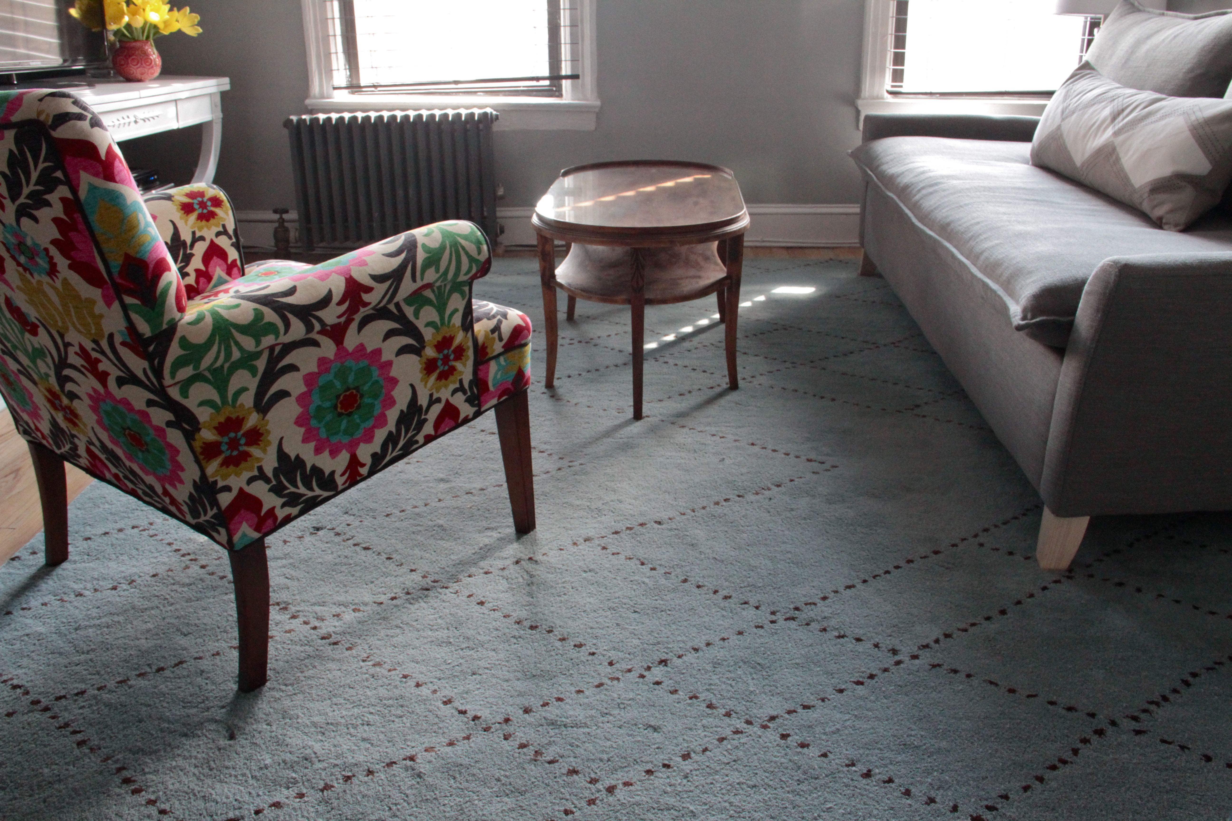 The rug was a risk, but I liked the pattern, and wanted to try something trendy. We thought it was darker when we ordered it, but we worked with it just the same when we got it. Speed was of the essence.