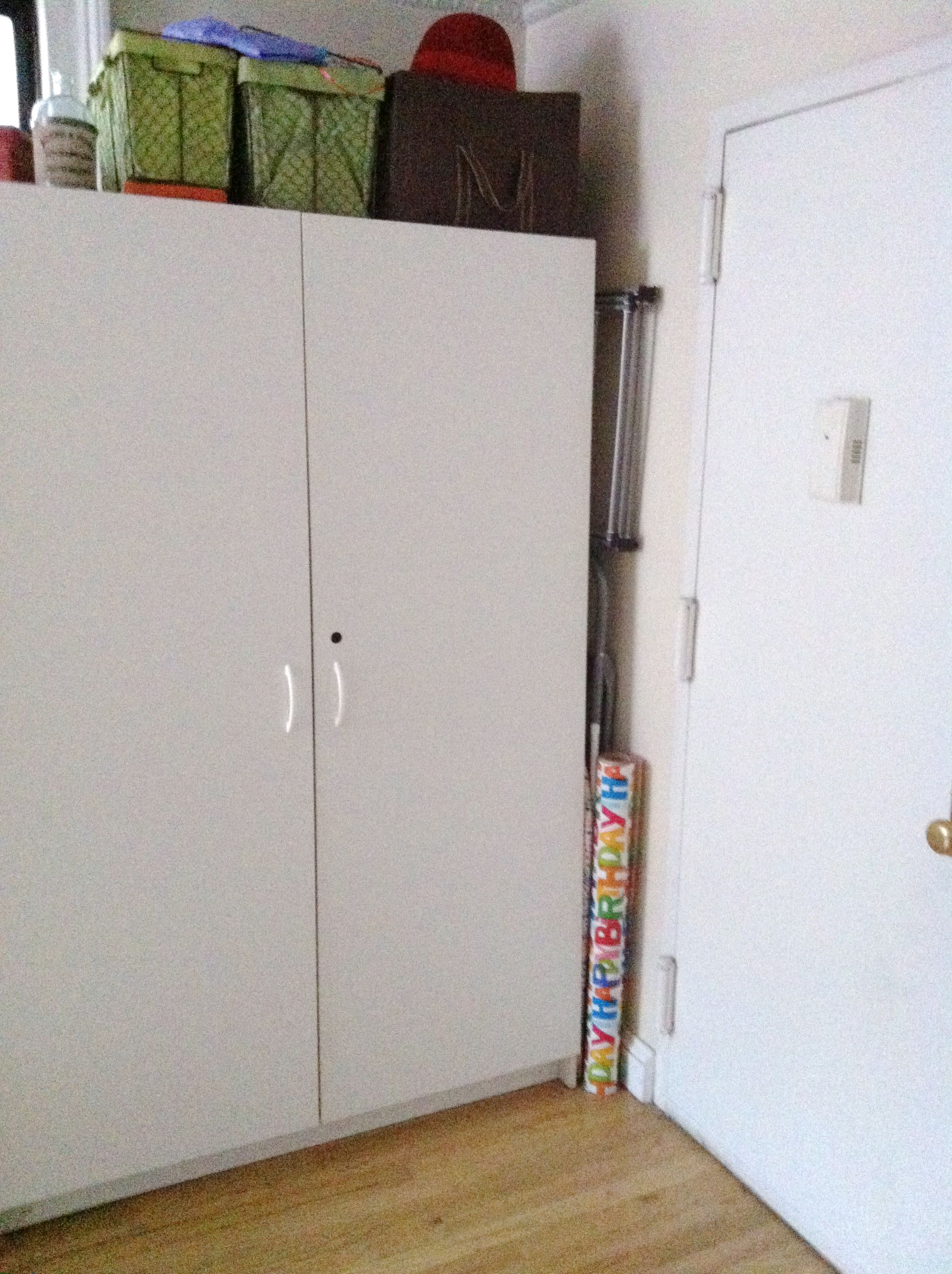 """BEFORE: The beast. This is/was the only """"closet"""" that the new apartment had. But it created a problem for us in that it was right where our eating area needed to be. So we had the landlord take it away. Now we have to carve out a bit of closet space elsewhere in the apartment."""