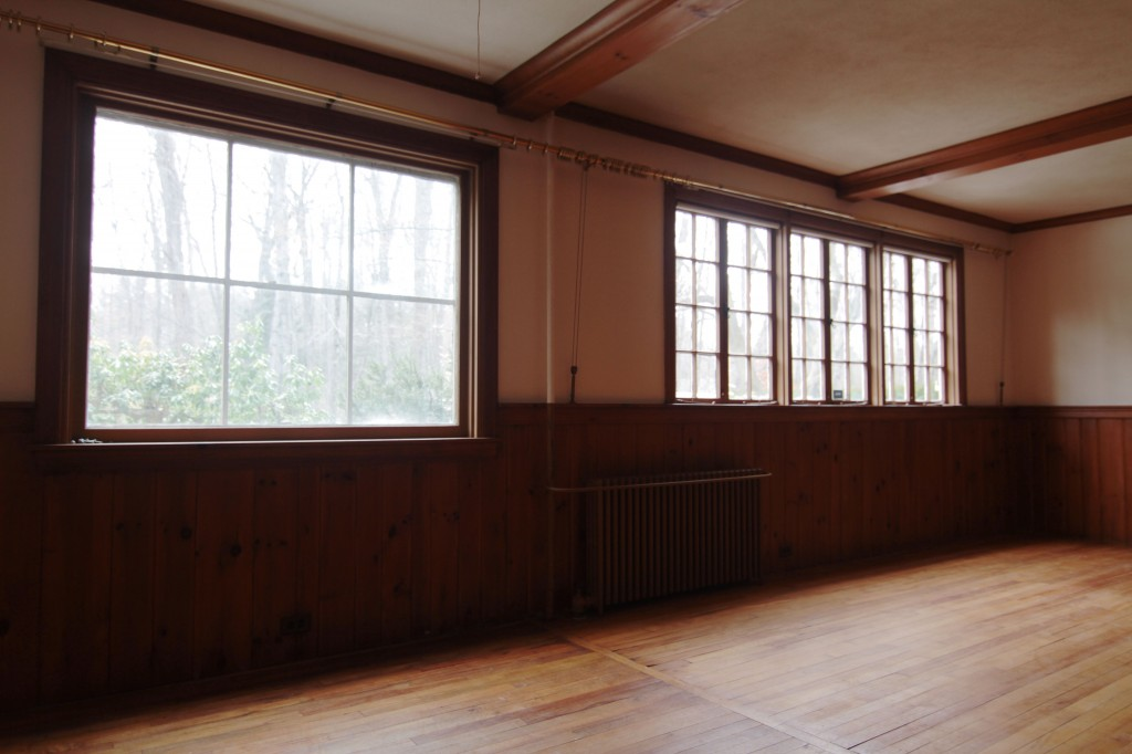 BEFORE: Views onto a wooded park, and lots of character in real wood paneling and faux beams. So English, right?