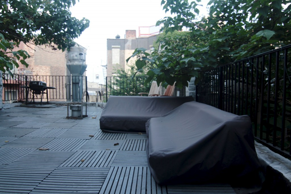 AFTER: The sofas - Tillary outdoor sofas from West Elm - are covered because of all the thunderstorms we've been having. I neglected to uncover them for these pictures since the covers we chose are grey, and we don't have any pillows yet. In other words, it looks pretty similar.